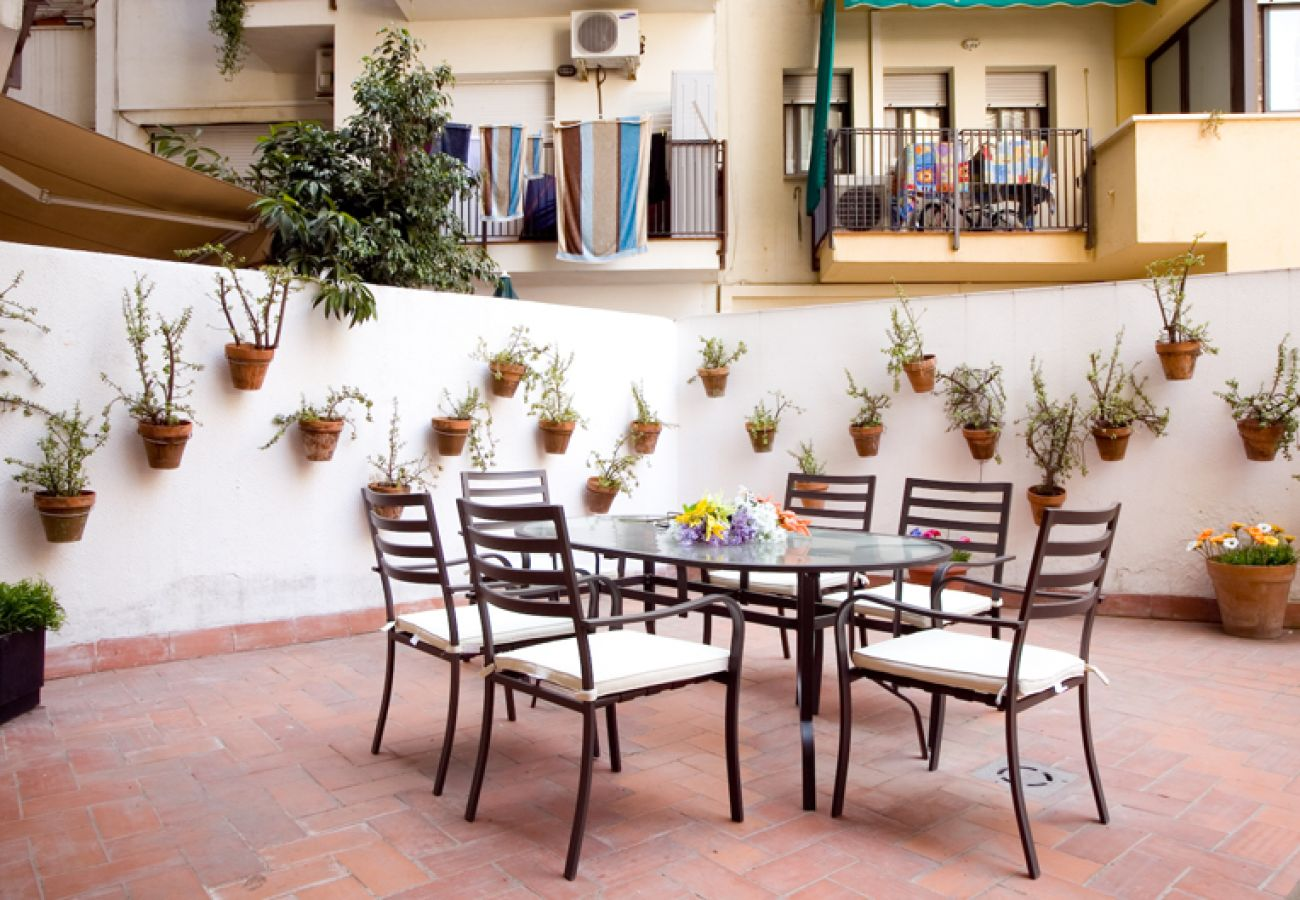 big terrace with tables and chairs in Barcelona close to Plaza España