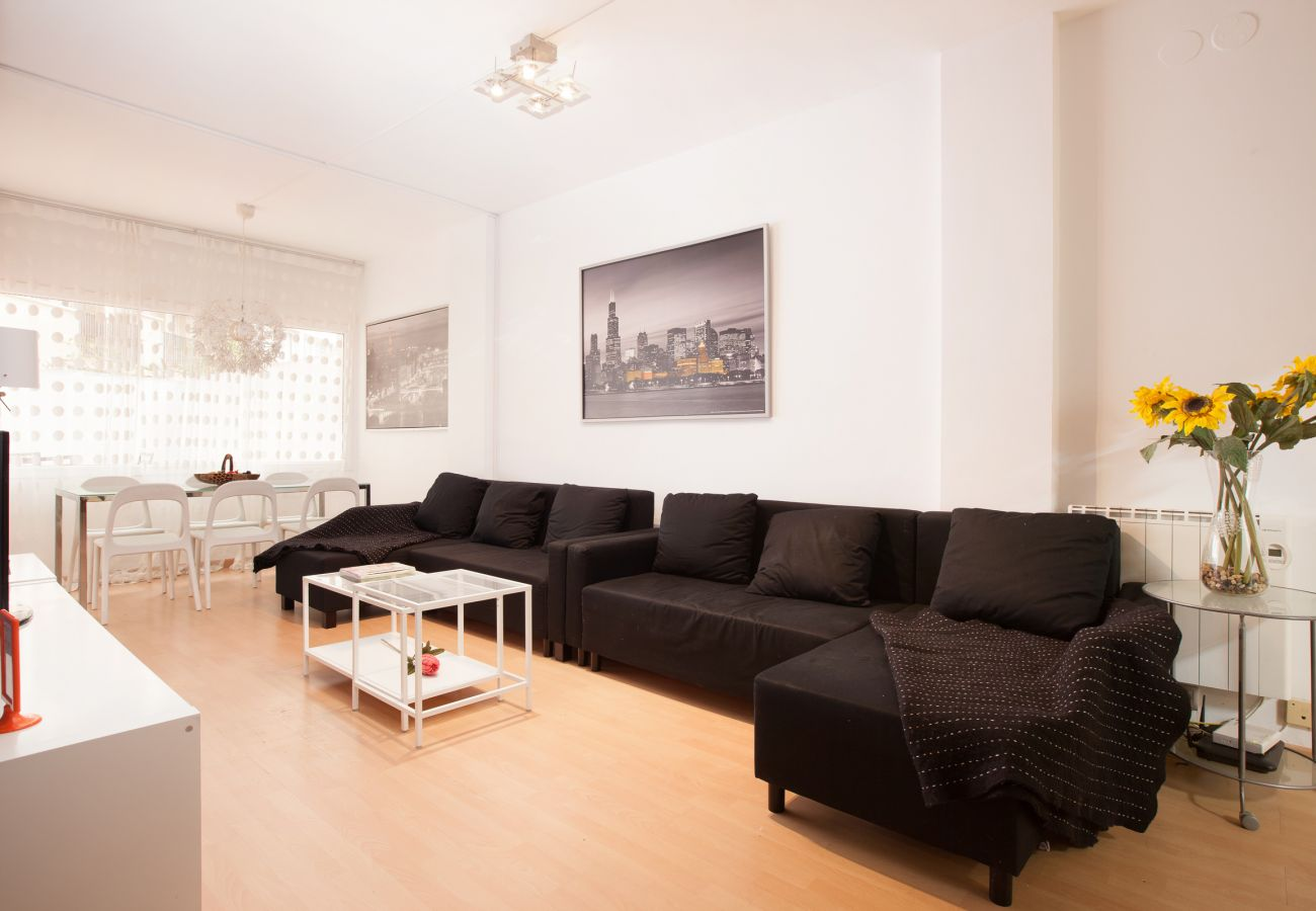 large couch in the living room of 4-bedroom 2 bathroom apartment close to Fira Barcelona