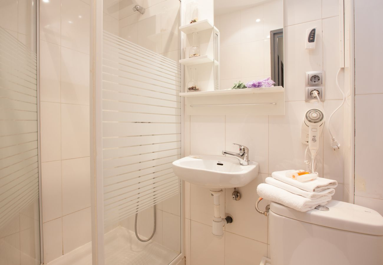 full bathroom with shower and heating