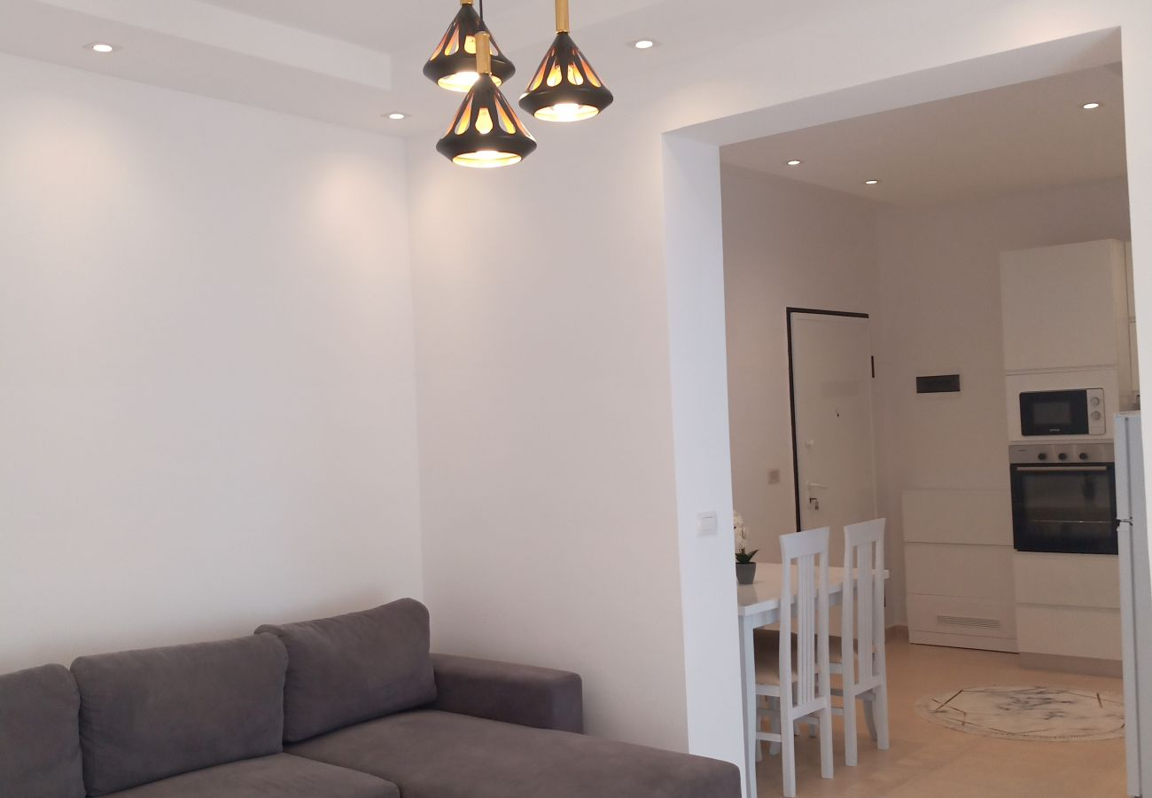 Double sofa bed in living room, kitchen and dining table in one bedroom apartment in Vlora