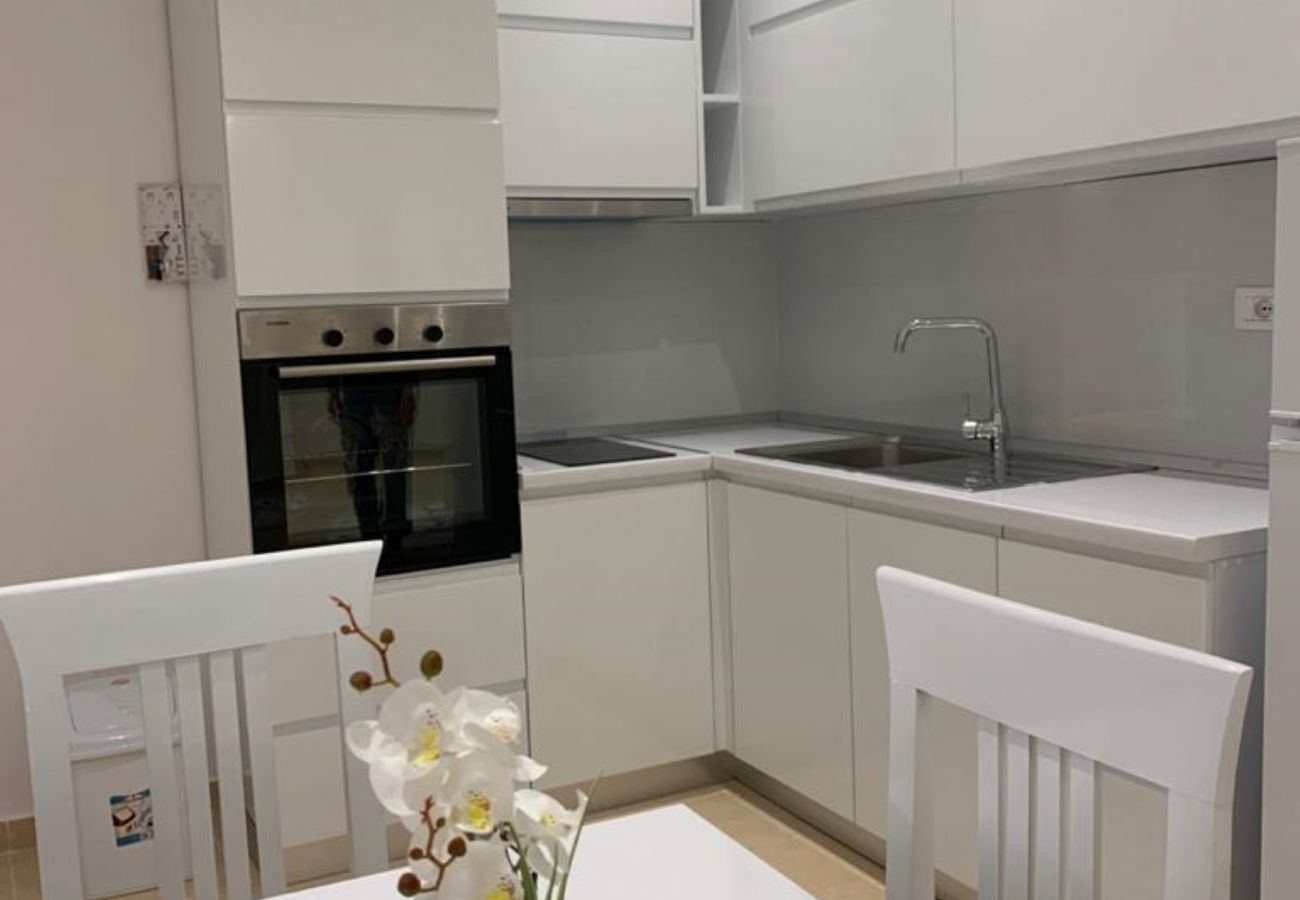 Kitchen and dining table in one bedroom apartment in Vlora