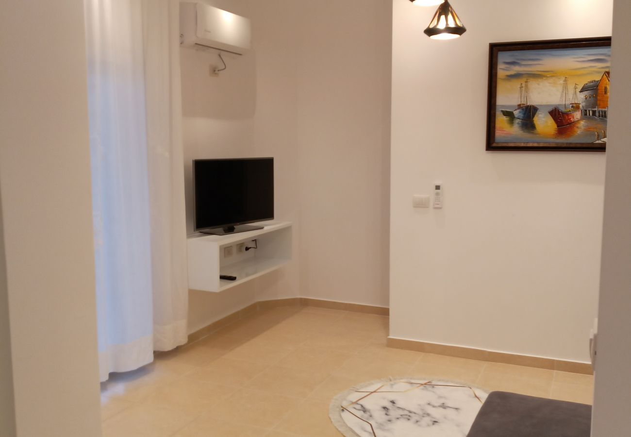 Communal zone details - TV and a Painting in one bedroom apartment in Vlora