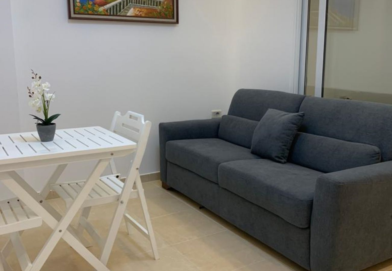 Living room with dining table in one bedroom apartment in Vlora