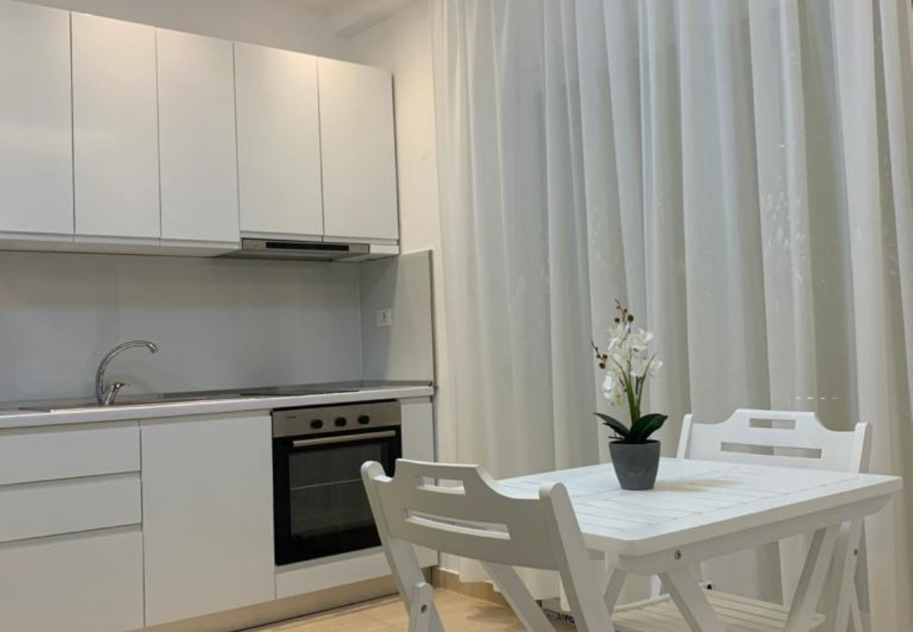 Kitchen with dining table in one bedroom apartment in Vlora
