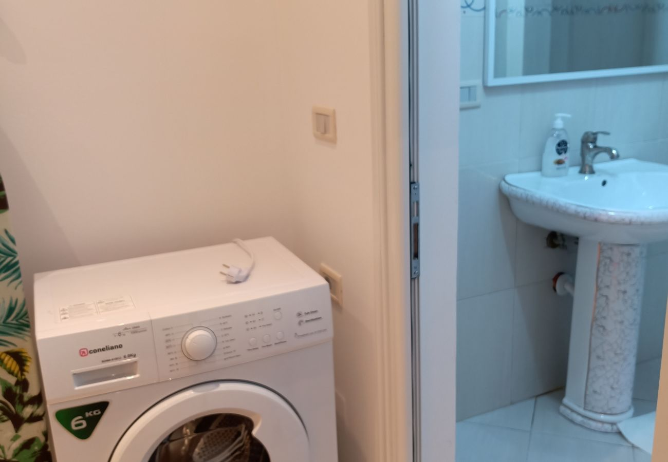 Bathroom sink and washing machine in one bedroom apartment in Vlora