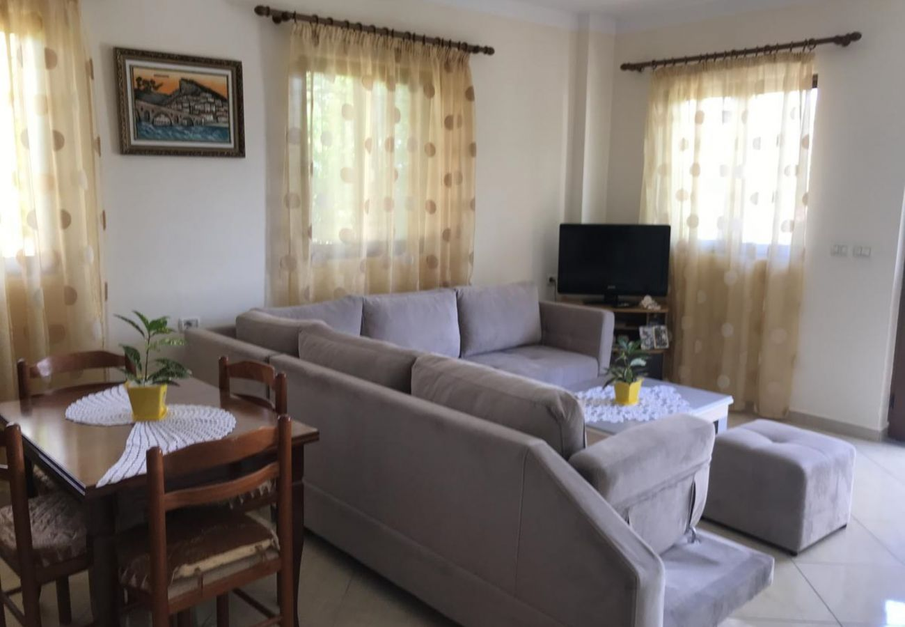 Living room with dining tablein a 2 bedroom apartment in Ksamil