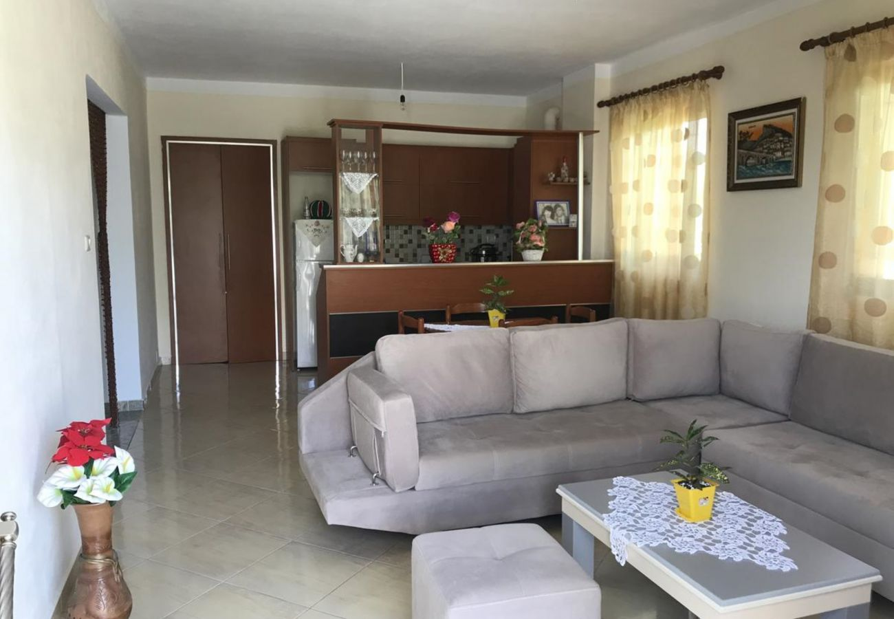Living room with kitchen in a 2 bedroom apartment in Ksamil