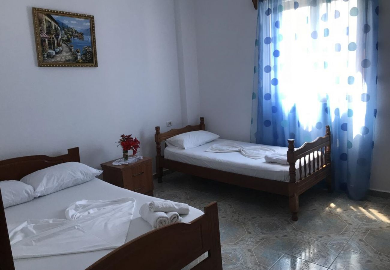 Bedroom with one double and one single bed, in a two bedroom flat in Ksamil, near the beach.