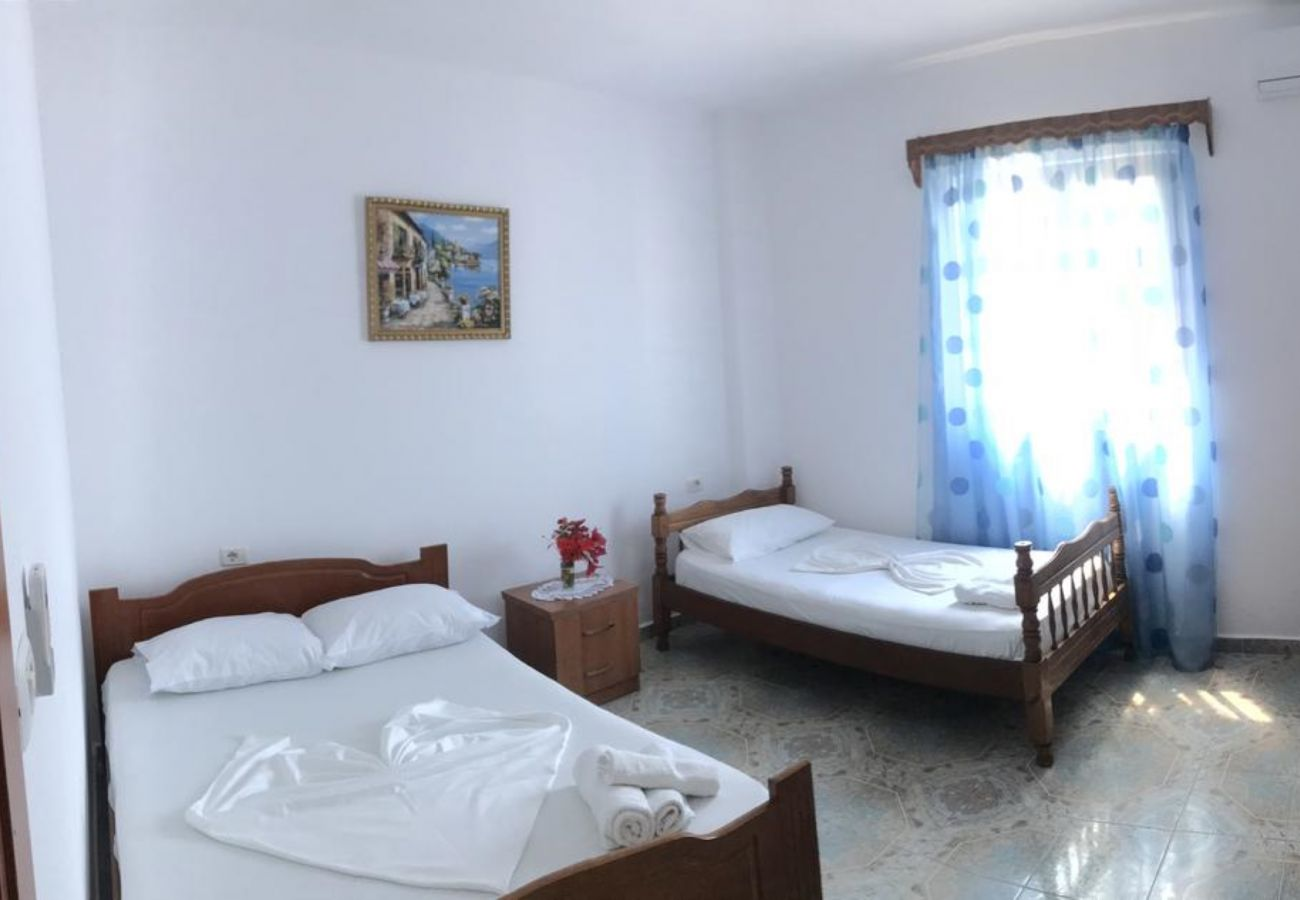 one double and one single bed in a 2 bedroom flat in Ksamil